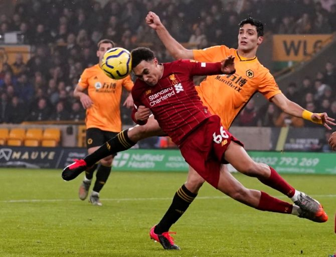 Liverpool's Trent Alexander-Arnold wins the ball as he vies with Wolverhampton Wanderers' Raul Jimenez