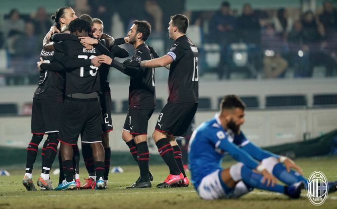 AC Milan players celebrate after scoring against Brescia in their Serie A match at San Siro on Friday