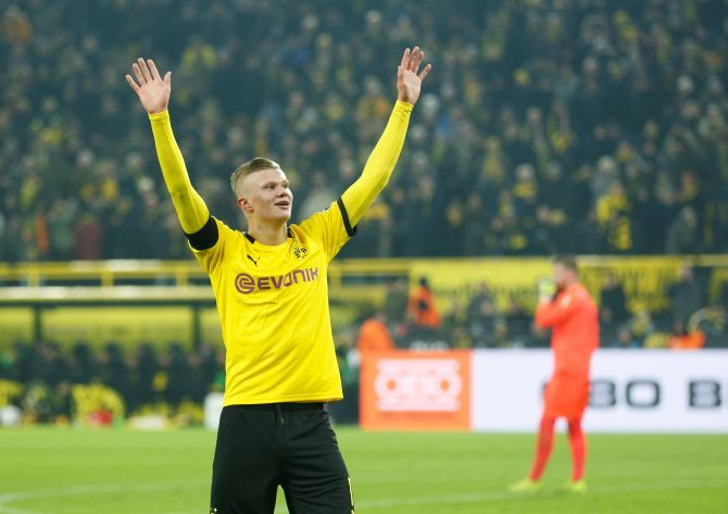 Borussia Dortmund's Erling Braut Haaland celebrates scoring their fifth goal against FC Cologne in their Bundesliga match at Signal Iduna Park in Dortmund on Friday