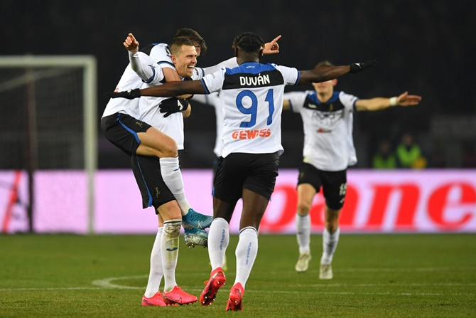 Atlanta's Josip Ilicic, centre,  celebrates scoring with teammates during the Serie A match against Torino FC