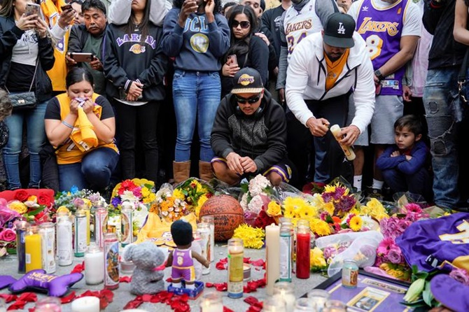 Mourners gather in Microsoft Square near the Staples Center to pay respects to Kobe Bryant.