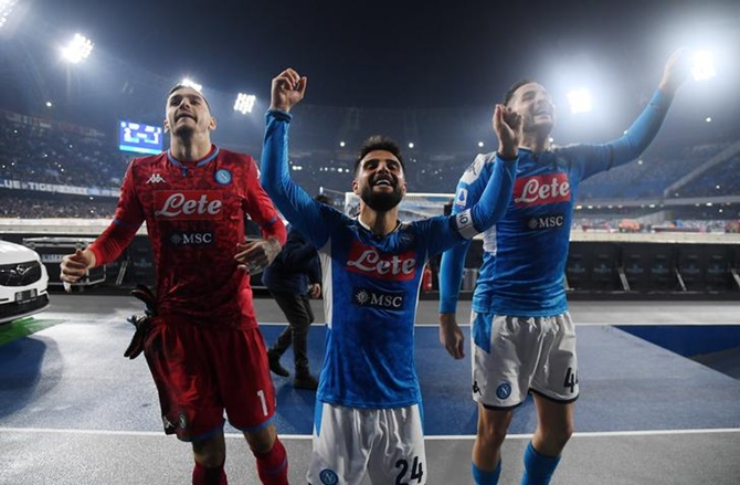 Napoli's Lorenzo Insigne celebrates with teammates after the Serie A match against Juventus, in Naples, on Sunday.