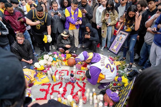 Mourners place tributes as they gather in Microsoft Square near the Staples Center to pay respects to Kobe Bryant