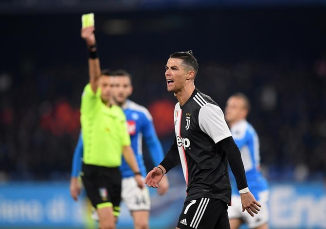 Juventus' Cristiano Ronaldo is shown the yellow card by referee Maurizio Mariani.