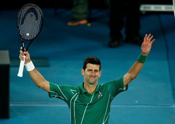 Djokovic sets up Federer showdown; Barty, Kenin cruise