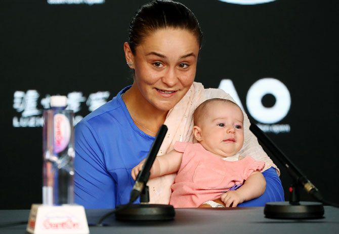 World No 1 Ashleigh Barty holds her niece Olivia during a press conference after losing her semi-final match against Sofia Kenin at this year's Australian Open.