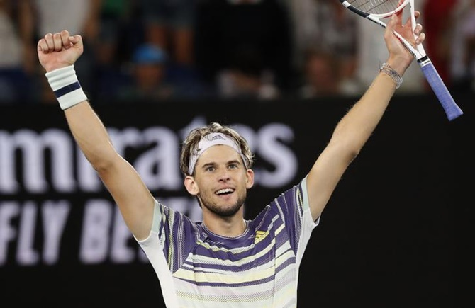Austria's Dominic Thiem celebrates victory over Germany's Alexander Zverev in the men's singles semi-final at the Australian Open, in Mebourne, on Friday