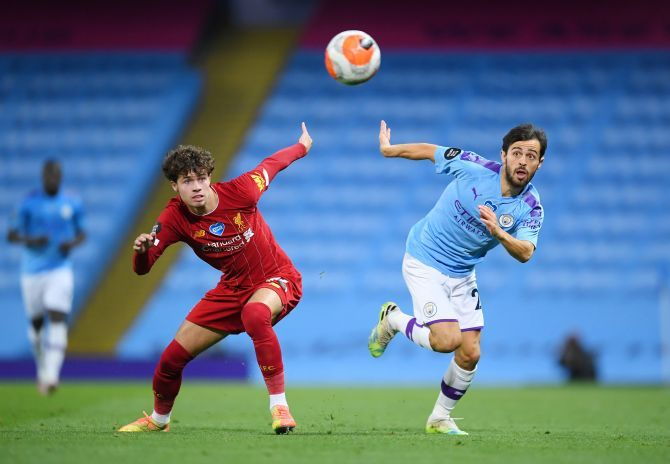 Liverpool's Neco Williams and Manchester City's Bernardo Silva go for the ball