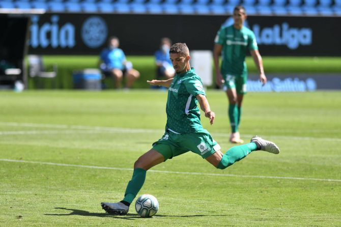 Real Betis' Zouhair Feddal shoots to score against Celta Vigo during their La Liga match
