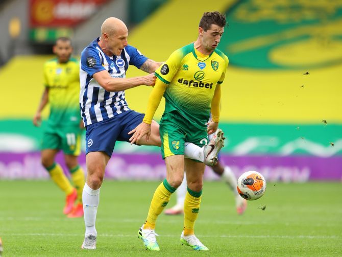 Brighton & Hove Albion's Aaron Mooy in action vies with Norwich City's Kenny McLean during their match at Carrow Road, Norwich