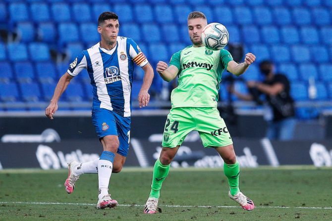 CD Leganes' Kevin Rodrigues (right) competes for the ball with RCD Espanyol's Javi Lopez