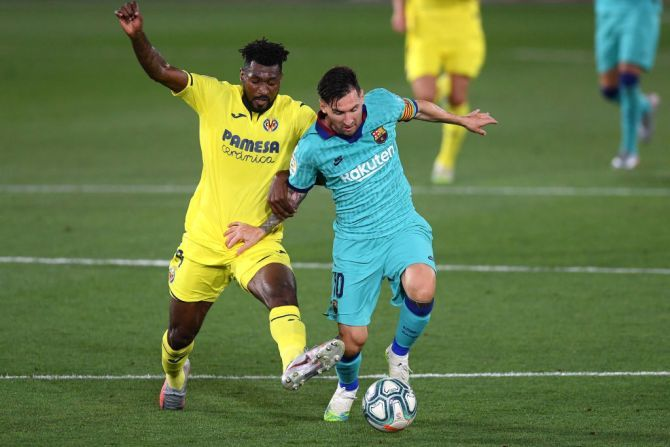 Barcelona's Lionel Messi is challenged by Villarreal's Andre-Frank Zambo Anguissa