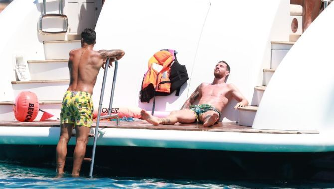 Lionel Messi and Luis Suarez on the yacht