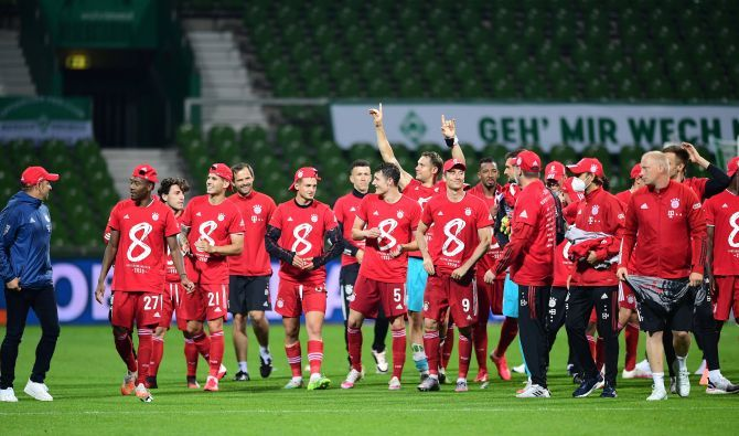 Bayern Munich players celebrate winning their Bundesliga title after defeating Werder Bremen at Weser-Stadion, in Bremen, Germany, on Tuesday