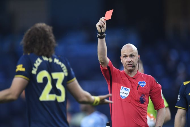 Arsenal's David Luiz is shown a red card by referee Anthony Taylor