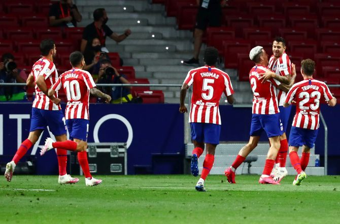 Atletico Madrid's Vitolo celebrates with teammates after netting their first goal against Real Valladolid at Wanda Metropolitano in Madrid on Saturday
