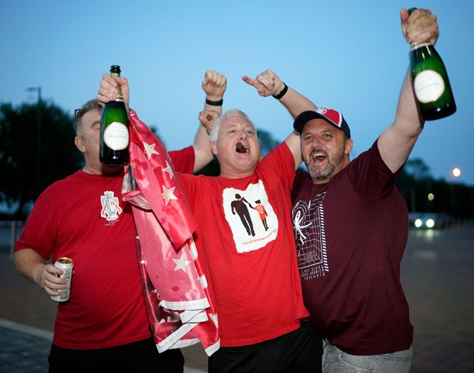 Liverpool fans celebrate winning the English Premier League title following Chelsea's victory against Manchester City on Thursday