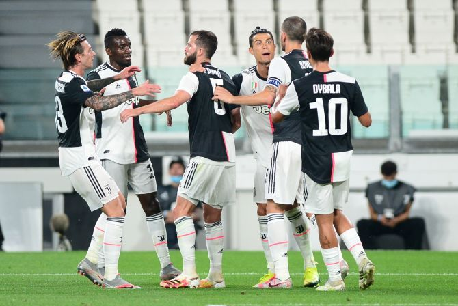 Juventus' Cristiano Ronaldo celebrates with teammates after scoring their second goal from the penalty spot during their Serie A match against Lecce at Allianz Stadium, Turin