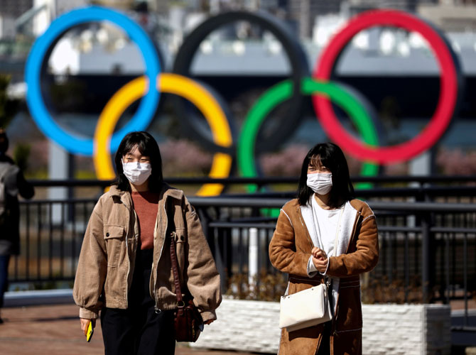 Japan denies considering vaccine priority for athletes