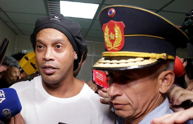 Former Brazil and Barcelona footballer Ronaldinho leaves Paraguay's Supreme Court after testifying in Asuncion, Paraguay, on Friday.