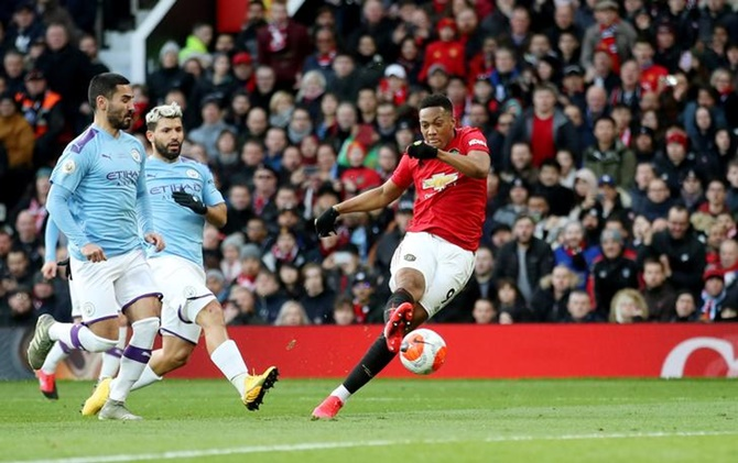 Anthony Martial puts Manchester United ahead in the Premier League match against Manchester City, at Old Trafford, in Manchester, on Sunday
