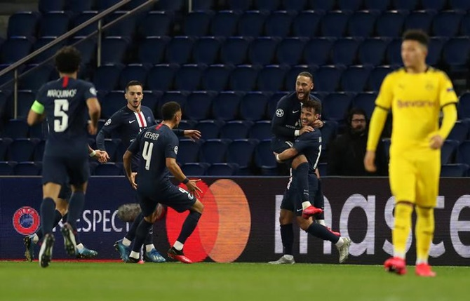 Juan Bernat celebrates scoring Paris St Germain's second goal with Neymar and teammates.