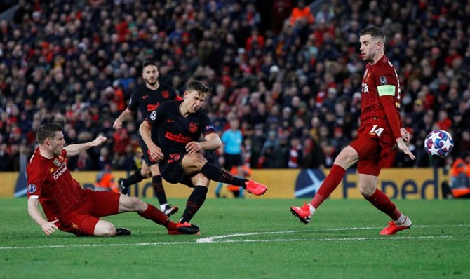 Marcos Llorente scores Atletico Madrid's second goal in the Champions League Round of 16 second leg against Liverpool, at Anfield, Liverpool, on Wednesday