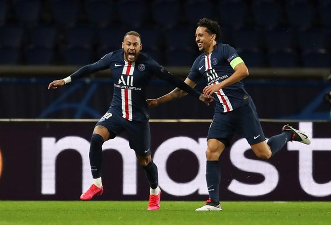 Neymar celebrates scoring Paris St Germain's first goal with Marquinhos during  the Champions League Round of 16 second leg match against Borussia Dortmund