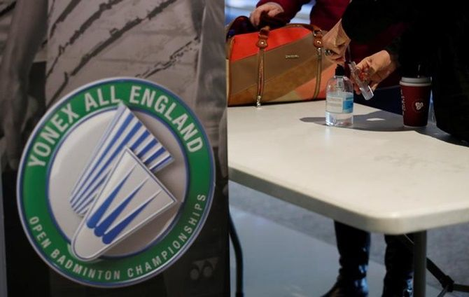 A fan uses hand sanitizer at Arena Birmingham, during the All England Open Badminton Championships