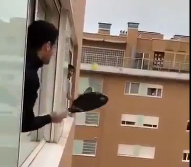 In this video posted on Twitter, people in Italy are seen playing tennis in their balconies during a lockdown last week