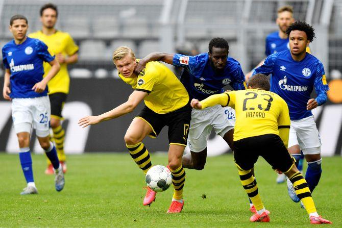 Dortmund's Erling Braut Haaland and Schalke's Salif Sane, vie for possession during their Bundeliga match on Saturday