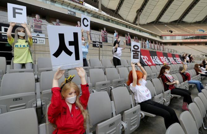 Mannequins are placed in spectator seats to cheer South Korea's football club FC Seoul team during a match against Gwangju FC, which is held without fans due to the coronavirus disease (COVID-19) outbreak, in Seoul, South Korea, on Sunday