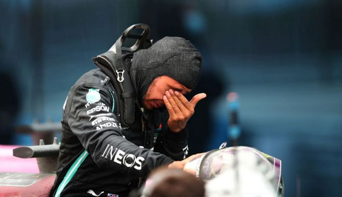 Mercedes GP's Lewis Hamilton wipes his tears as he celebrates winning a 7th F1 World Drivers Championship in parc ferme at the F1 Grand Prix of Turkey at Intercity Istanbul Park in Istanbul, Turkey, on Sunday