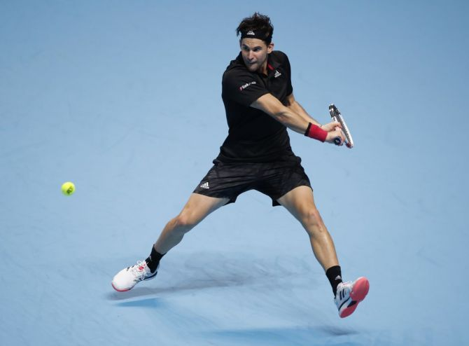 Austria's Dominic Thiem in action during his ATP Finals semi-final against Serbia's Novak Djokovic at the 02 Arena in London on Saturday