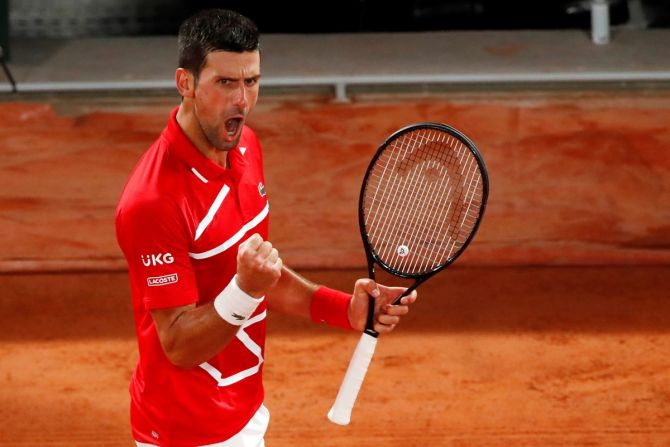 Serbia's Novak Djokovic celebrates winning a point during his fourth round match against Russia's Karen Khachanov at the French Open on Monday.