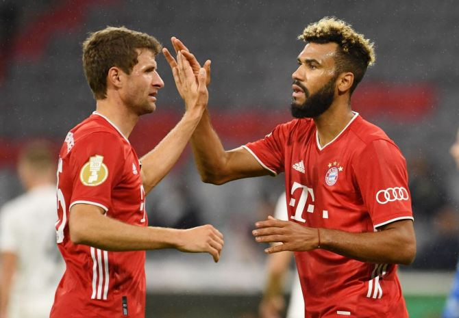 Bayern Munich's Eric Maxim Choupo-Moting celebrates with teammates on scoring their first goal against FC Duren in their German Cup match at Allianz Arena, Munich on Thursday