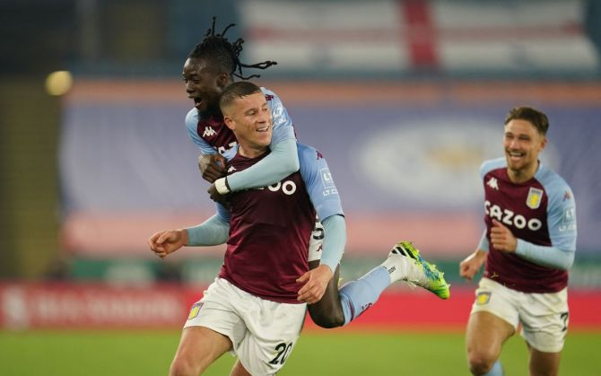 Aston Villa's Ross Barkley celebrates with Bertrand Traore Pool on scoring their first goal at  King Power Stadium, Leicester
