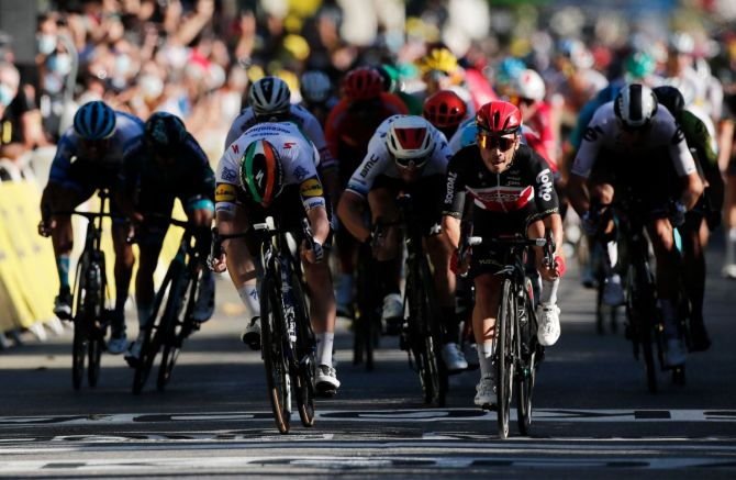 Lotto Soudal rider Australia's Caleb Ewan wins the third stage ahead of Deceuninck-Quick Step's Irish rider Sam Bennett during the Nice to Sisteron stage at the Tour de France on Monday