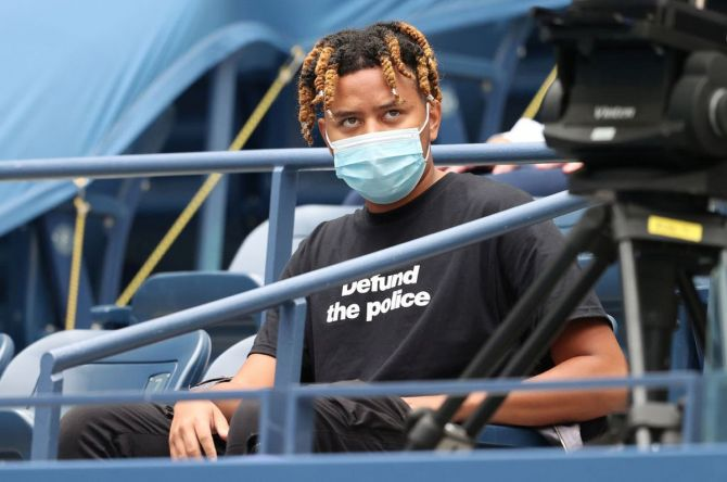 Naomi Osaka's boyfriend, rapper YBN Cordae looks on before the US Open final on Saturday