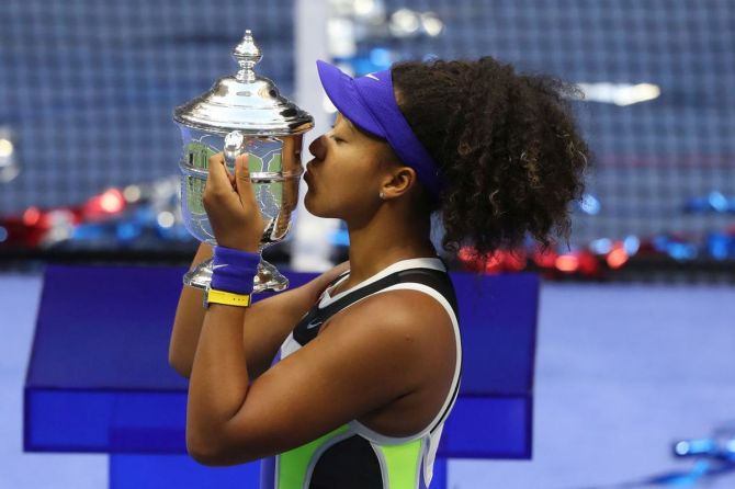 Japan's Naomi Osaka kisses the trophy after winning the US Open title on Saturday