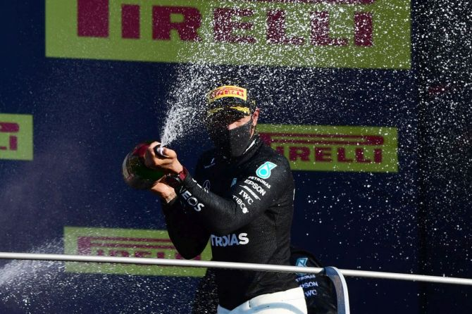 Race winner Lewis Hamilton of Great Britain and Mercedes GP celebrates on the podium
