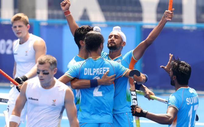 Mandeep Singh celebrates scoring India's second goal