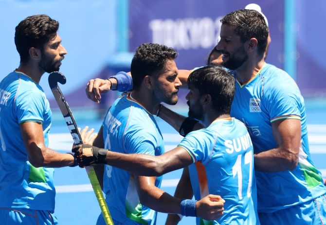 Harmanpreet Singh celebrates scoring India's third goal with teammates during the Olympics men's hockey bronze medal match against Germany, at Oi Hockey Stadium in Tokyo, on Thursday.