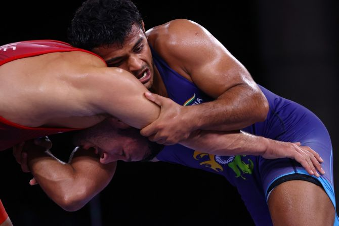 India's Deepak Punia in action against San Marino's Myles Nazem Amine during the Olympics men's 86kg Freestyle wrestling bronze medal bout,