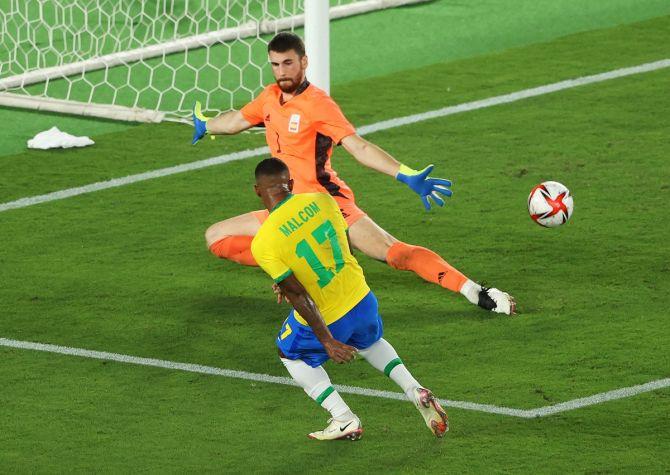 Malcom scores past Spain's goalkeeper Unai Simon in extra-time to put Brazil ahead.