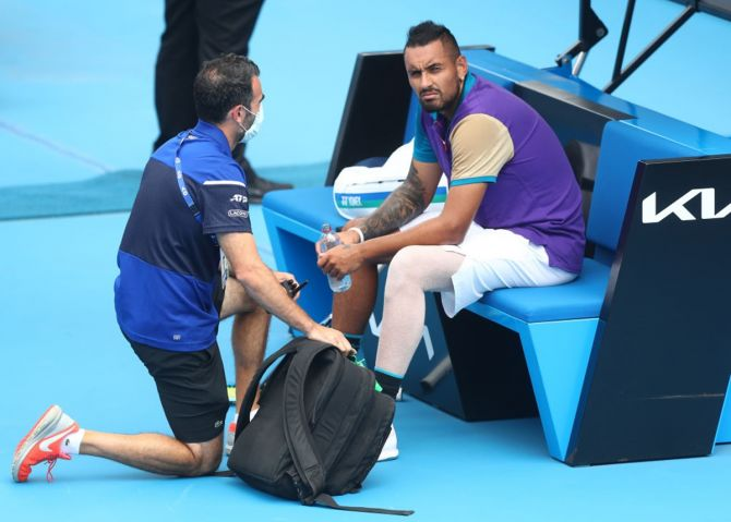 Australia's Nick Kyrgios reacts while receiving medical attention during his match against Croatia's Borna Coric