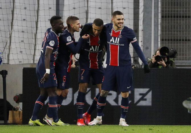 Kylian Mbappe celebrates with teammates after scoring Paris St Germain's first goal with teammates in Sunday's Ligue 1 match against Olympique de Marseille.