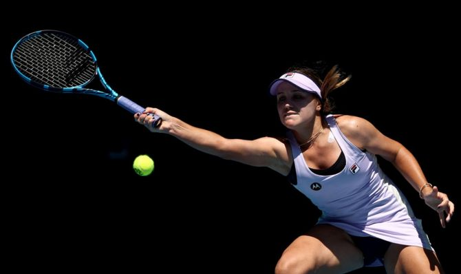Sofia Kenin of the United States plays a forehand in her first round match against Australia's Maddison Inglis