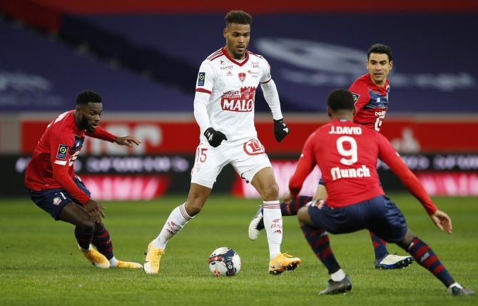 Brest's Steve Mounie tries to make his way past Lille's Jonathan David in Sunday's Ligue 1 match.