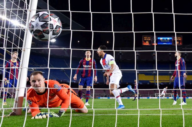 FC Barcelona's keeper Marc-Andre ter Stegen reacts as Moise Keane scores Paris Saint-Germain's third goal during the UEFA Champions League Round of 16 match at Camp Nou in Barcelona